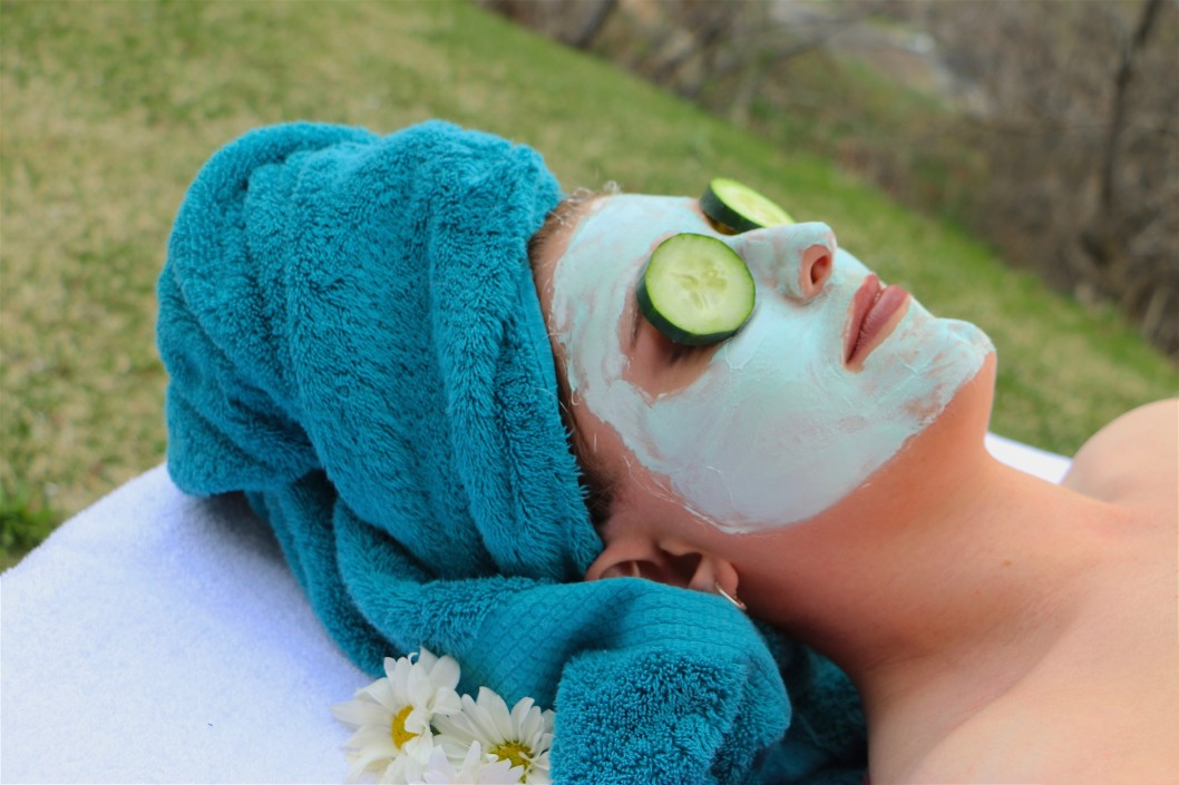 Young woman enjoying a relaxing outdoor facial