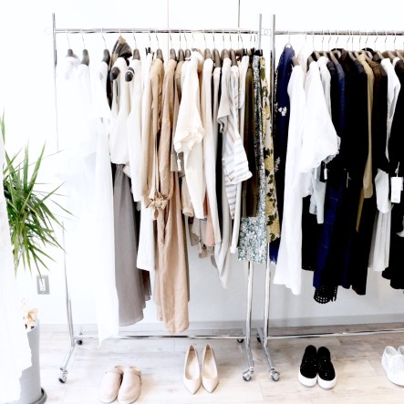 Clothing hanging up inside of a closet